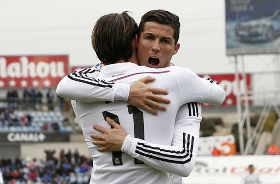 Real Madrid's Cristiano Ronaldo congratulates his teammate Gareth Bale after scoring a goal against Getafe during their Spanish first division soccer match at Colisseum Alfonso Perez stadium in Getafe